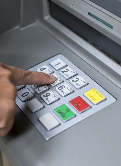 Reward_technology_Unifiid_and_Unifi.id_Banks_typing_pin_at_ATM_machine